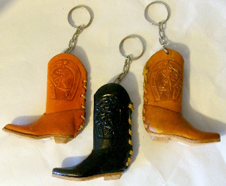 This Leather cowboy boot keychain is a great Western keyring big enough for a lighter to fit in. Easily carry a lighter with you in this cowboy boot key chain hand made in real leather in assorted colors.