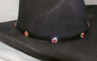 This Black leather Pink Crystal Flower hat band with Silver buckle is hand made in the USA with real rhinestones that are silver plated fastenings with a sterling silver belt buckle closure a great western hat band for cowboys or cowgirls.