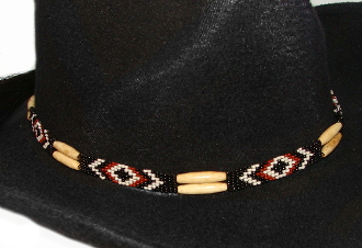 "This""Navajo Rust"" Horse hair natural bone hat band is hand made in the USA with genuine horse hair tassels closure with turquoise black and rust beads for all cowboys and cowgirls."