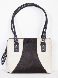"This Black and White Hair on Hide Scully Leather Handbag is a beautifully rich cow hair on a soft calf leather handbag for women. This western bag is large enough for all your cowgirl stuff with a 15"" x 10.75"" x 4"" purse size."