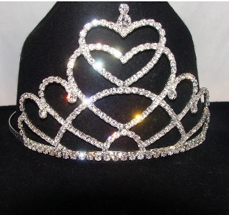 """Royal Hearts"" Rhinestone Cowboy hat tiara is proudly made in the USA for the queen of the rodeo to be crowned by this cowboy hat tiara is an exciting look an any cowgirl competing to be the horse show winner."
