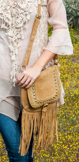 This Scully Womens Boar Suede Studded Fringe Western Handbag Purse has long full fringe bottom with a flap closure, adorned with golden studs and suede braiding to make this a beautiful accent to your western attire.