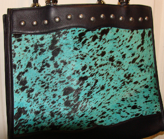 "The ""Cheyenne"" Turquoise Hair on Hide Scully Black Leather Handbag is a beautifully rich turquoise cow hair on a soft calf leather handbag for women."