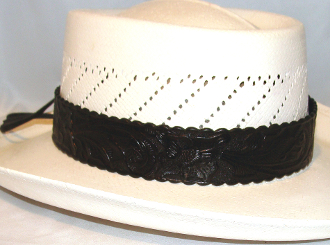 "This 1.5"" Tooled leather Black Cowboy Hat Band is for the person who is looking for a larger fitting hat band. This real leather tooled hat band fits the bigger cowboy hat sizes."
