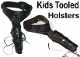 This Child single gun holster for kids is a hand tooled Black or Brown leather. A real leather gun belt or pistol holder made in the kids sizes. You can use this kids gun belt for a toy gun or the real pistol.