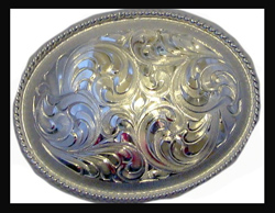 "This 4"" Sterling Silver Oval Western Belt buckle is made for gals or guys to go on your cowboy belt with this beautiful etched Sterling silver oval shaped belt buckle for any western cowboy or cowgirl."