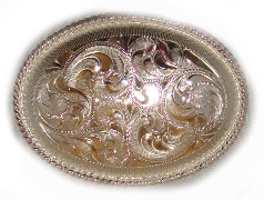"This 3"" Sterling Silver Oval Western Belt buckle is made for the little gals or guys to go on a cowboy belt with this beautiful etched Sterling silver oval shaped belt buckle."