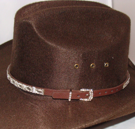 This Brown Leather Diamond Rhinestone Cowgirl Hat Band has diamond rhinestones and crystals throughout complete with a belt buckle closure a great western hat band for cowgirls.