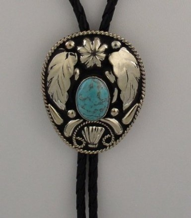 The Silver Leaf Turquoise Bolo Tie is a beautiful sterling silver plated large bolo with a turquoise inner stone and a raised leaf design that will dress up any cowboy or cowgirl shirt.