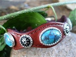 This Silver Concho Brown Leather Turquoise Bracelet is made in the USA with real stones with a turquoise stain and sterling silver plated studs and accents and a silver belt buckle closure a real cute cowgirl or cowboy look.