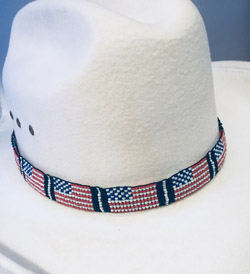This Beaded USA Flag Cowboy Hat Band is proudly made in the USA with 1 inch wide beads and really adds to your cowboy or cowgirl hat band with each bead being hand sewn with quality beads made with pride in the USA.