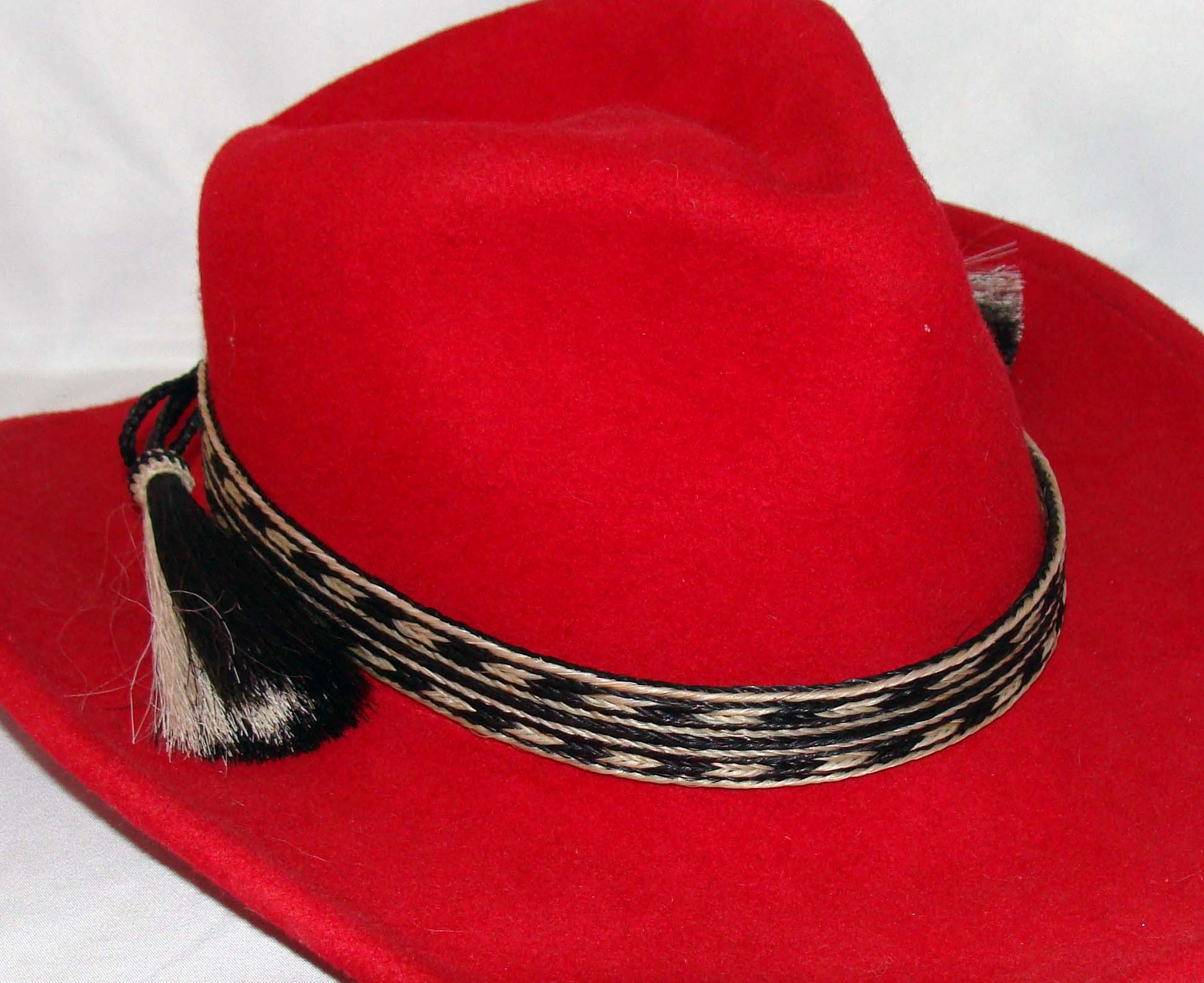 "The 3/4"" Black/White Double Row Horse Hair Tassel Hat Band is hand made with genuine horse hair that is hand weaved with great detail a cowboy hat band that really adds style to any cowboy or cowgirl hat."