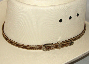 This Sterling Silver Blond Brown Horse hair hat band is hand made in the USA with genuine horse hair with a sterling silver belt buckle closure a great western hat band for cowboys or cowgirls.