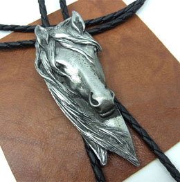 The Vintage Western Horse Head Bolo Tie is a large display of the loved horse with flowing main on a black bolo that certainly will dress up any cowboy or cowgirl shirt.