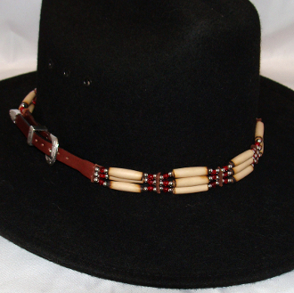 This Cow Bone and Brown Leather Silver Buckle Cowboy Hat Band is hand made in the USA with cow bones and genuine leather silver beads and a silver buckle closure for all cowboys and cowgirls.
