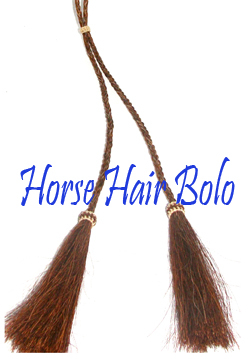 "This ""Overo"" Brown Horse Hair bolo tie is made in the USA with cruelty free horse hair in a 42"" long bolo string for a replacement or to where by itself making a great cowgirl or cowboy western look for any occasion."