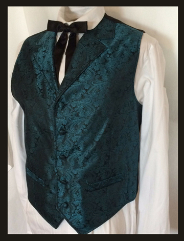 This Scully Mens Teal Paisley Dress Lapel western vest for western weddings or cowboy western dress vest with classic paisley print covered button front and welt pockets with back adjustable strap.